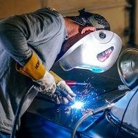 NCR man welding a car