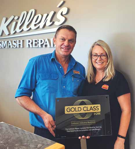 Michael and Natalie with the I-CAR Gold Class plaque